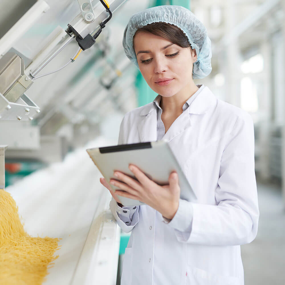 Food and Beverage worker applying checklist by tablet